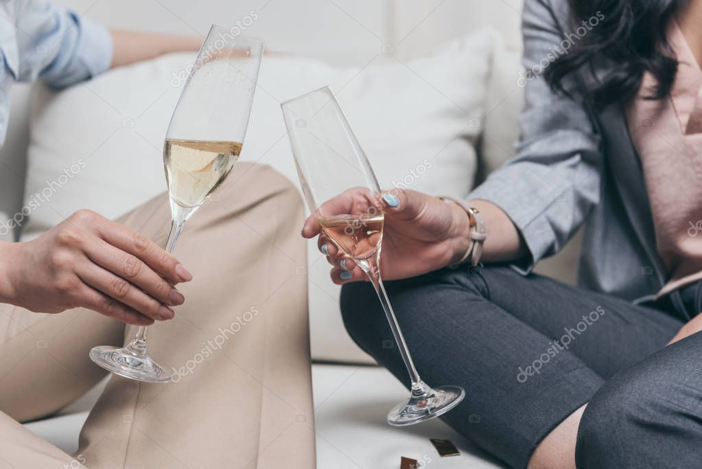 young women drinking champagne at home