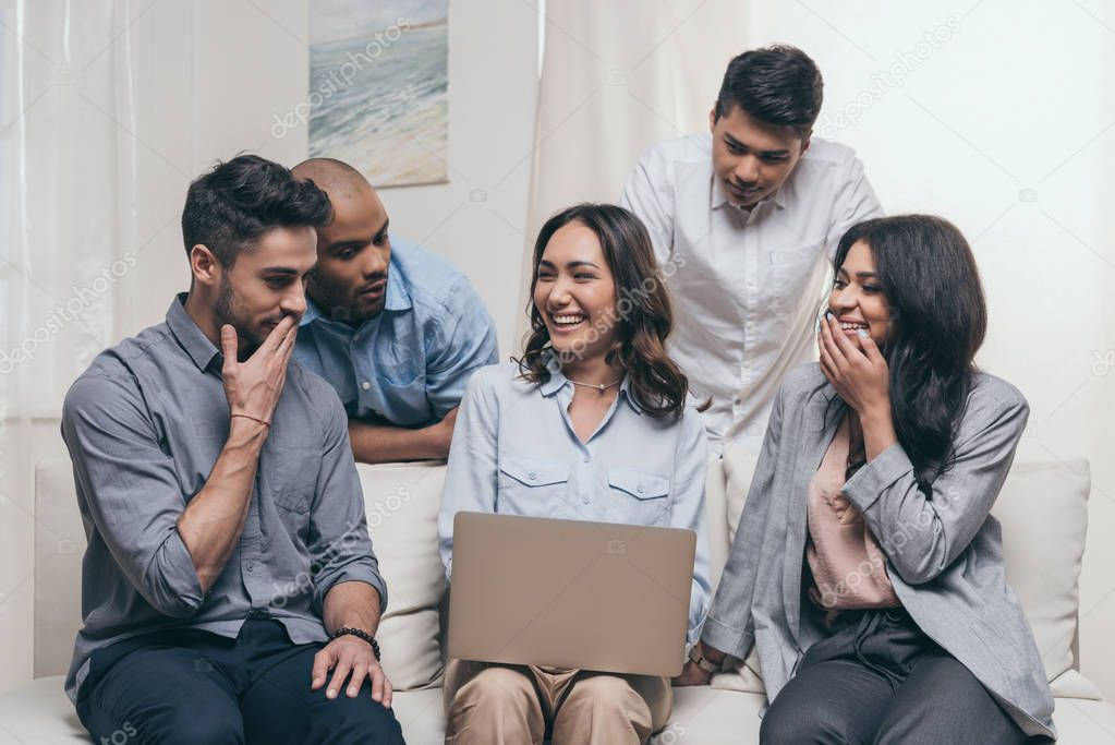 emotional friends using laptop at home