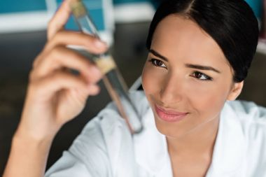 Scientist examining test tube