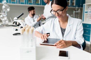 Scientist with digital tablet in lab