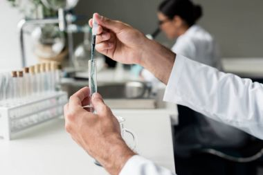 Scientist making experiment