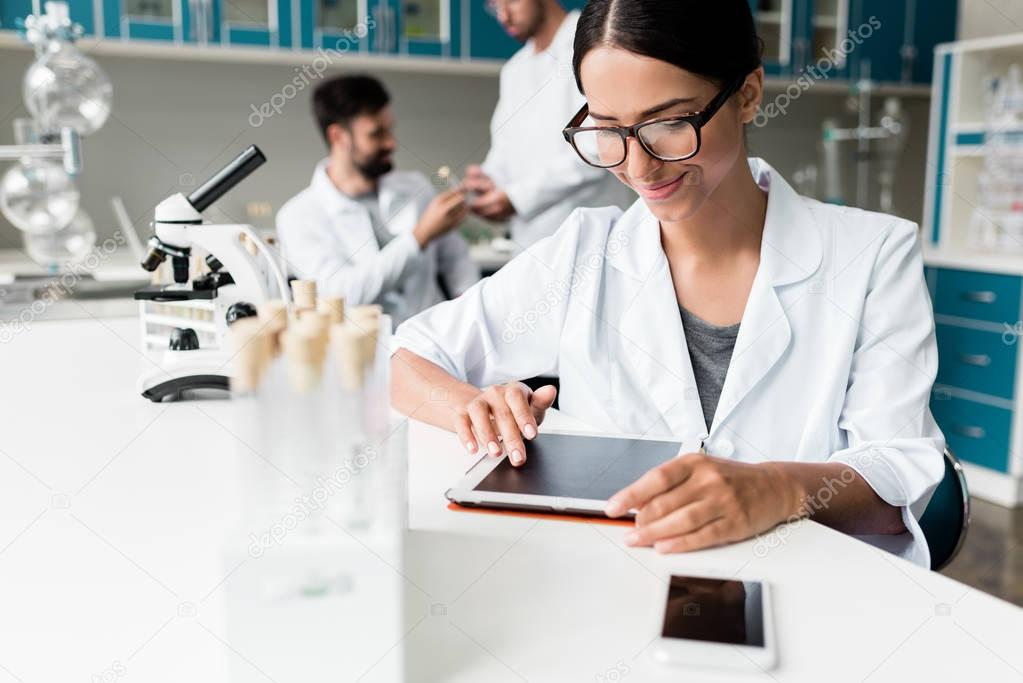 Scientist with digital tablet in lab