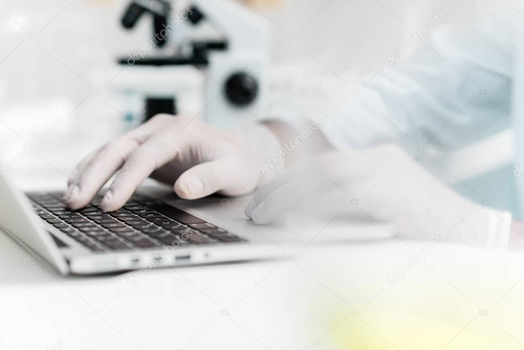 Scientist using laptop