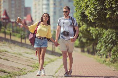 multiethnic couple walking in city