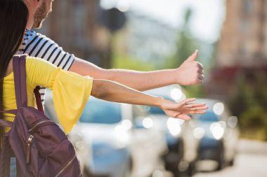 Couple hailing taxi