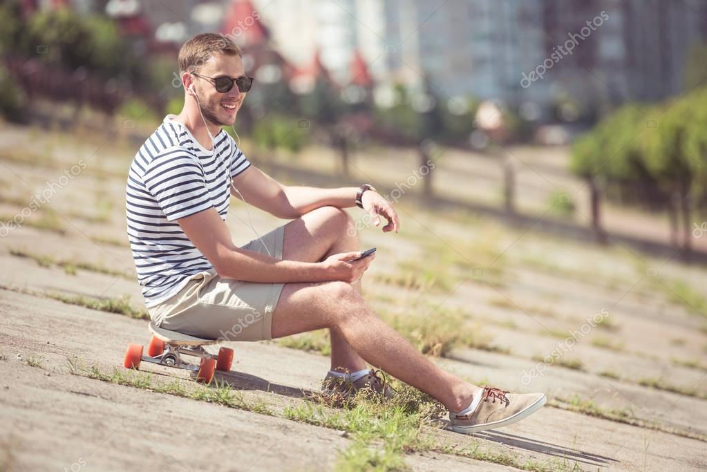 handsome man listening music