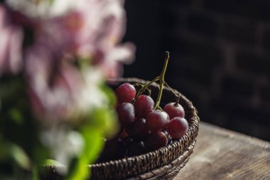 Red grapes on kitchen table