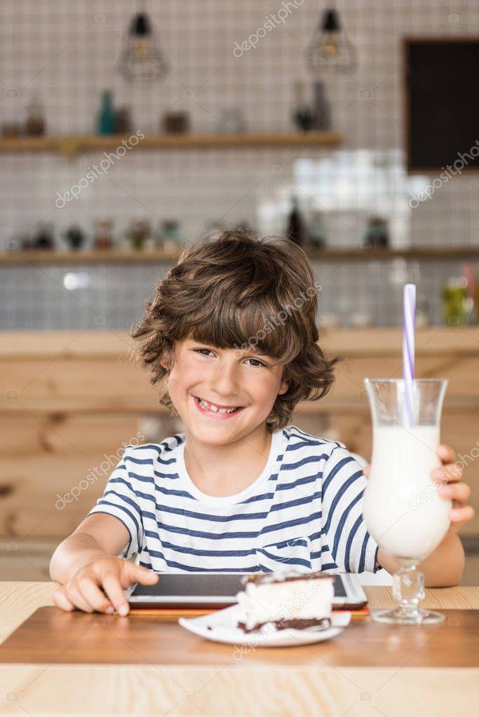 little boy with digital tablet