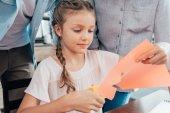 Fotografie little girl doing paper carving