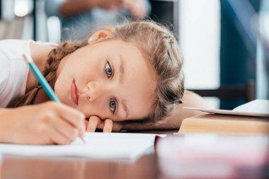 girl writing homework