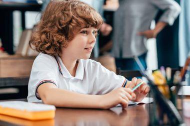 Boy sitting at school desk