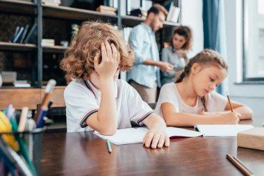 kids doing homework together