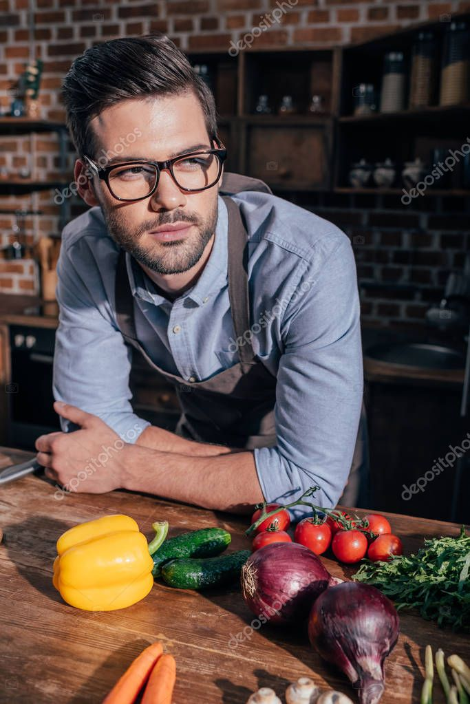 thoughtful young man at kitchen