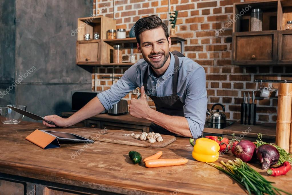 happy young man in kitchen