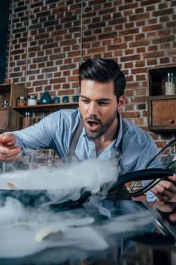 young man cooking