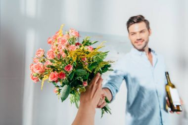 man giving bouquet to woman