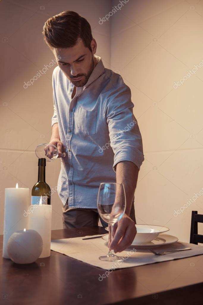 man preparing romantic dinner