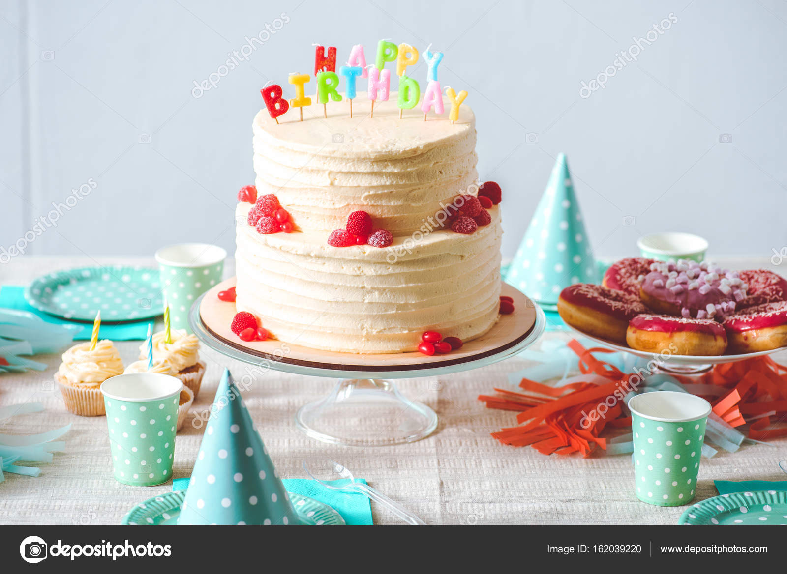Delicious Birthday Cake With Cupcakes Doughnuts And Paper Cups On Festive Table Photo By