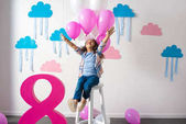 Fotografie girl with balloons at birthday party