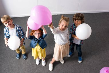 Children with balloons at birthday party