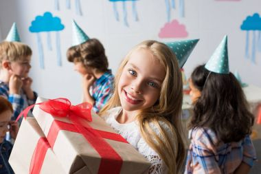 multiethnic kids with birthday presents