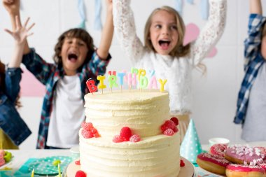 happy kids with birthday cake