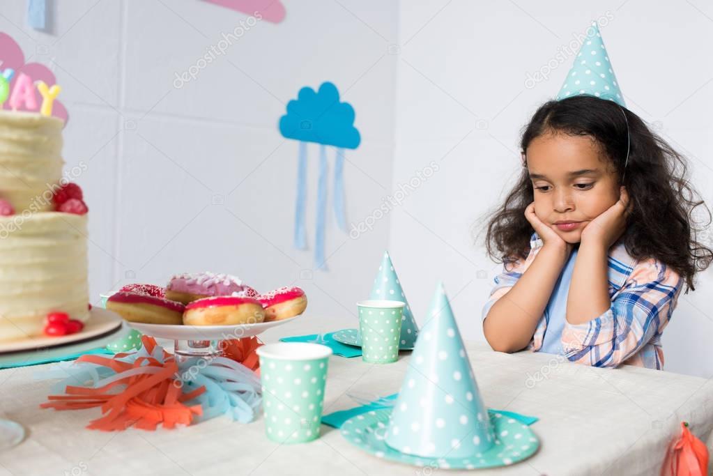upset child at birthday party