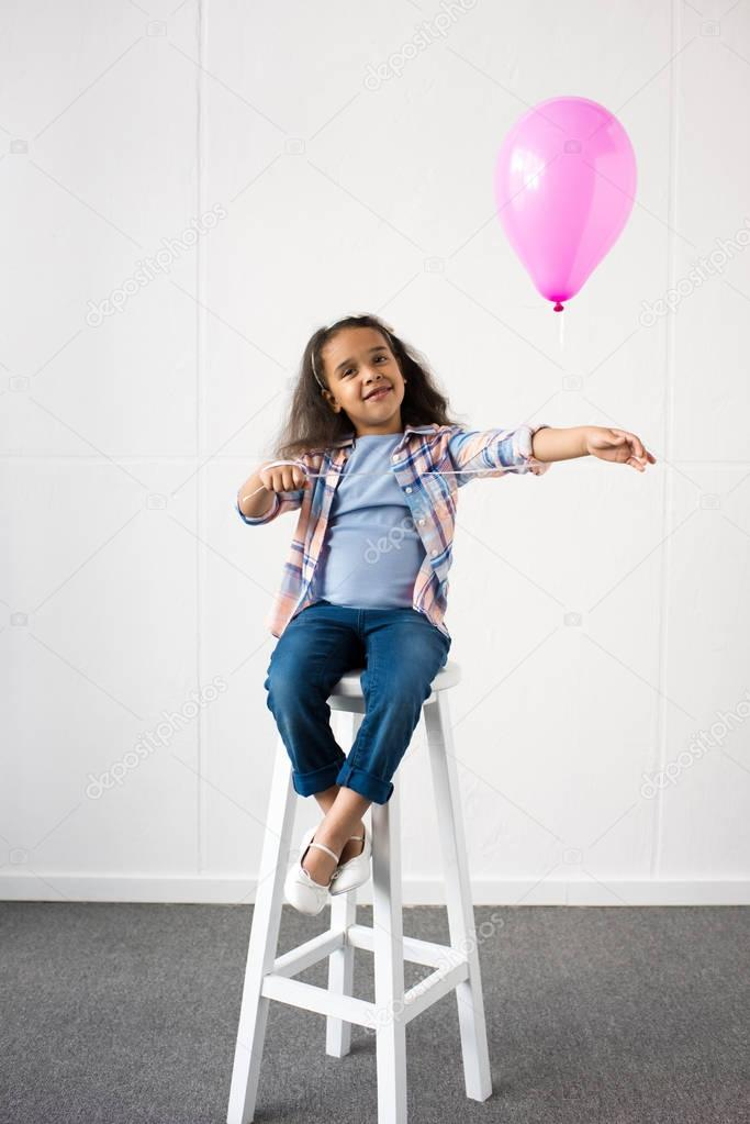 african american girl with balloon