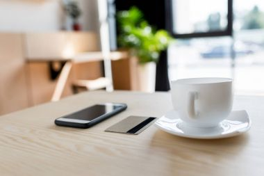 smartphone, credit card and cup of coffee