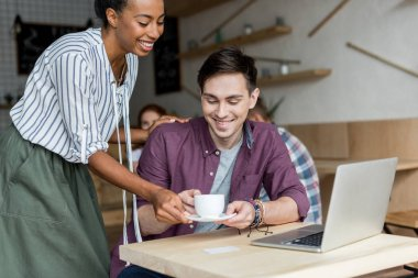girl giving coffee to boyfriend