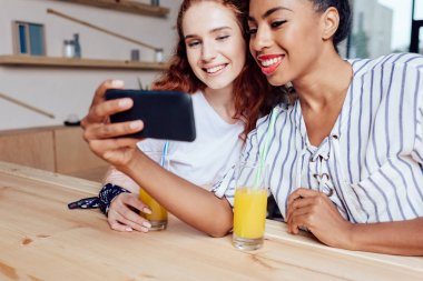 multiethnic girls using smartphone