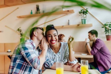 multiethnic couple in cafe