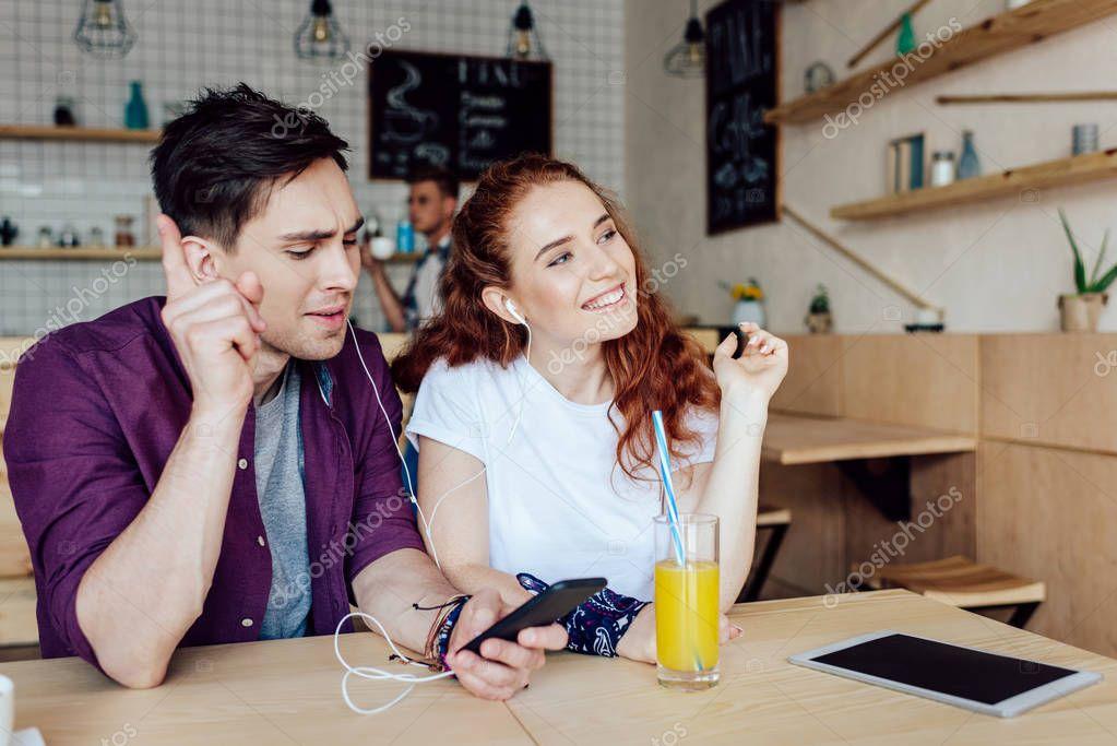 couple listening music in earphones