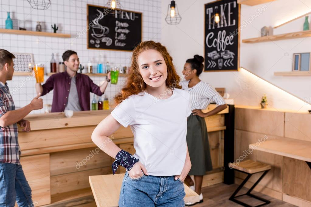 Redhead girl in cafe