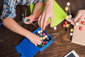 Photo family building atoms model