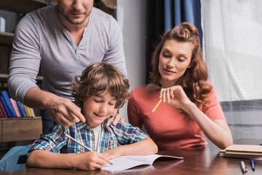 parents helping son with homework