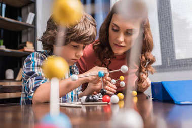 Family playing with atoms model