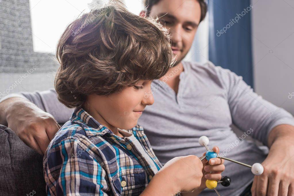 kid building atoms model