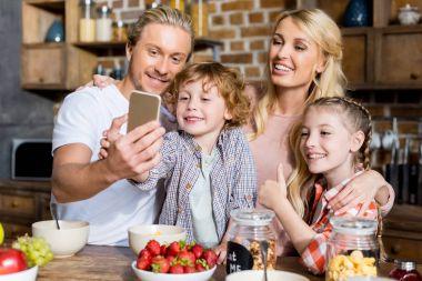 family taking selfie during breakfast
