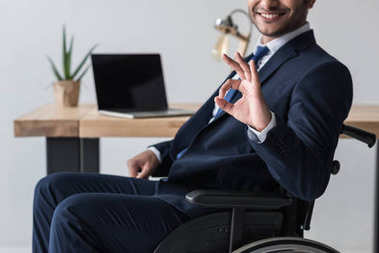 disabled businessman showing okay sign