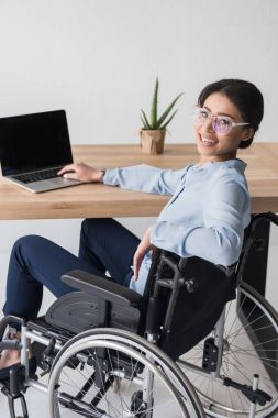 disabled african american businesswoman at workplace