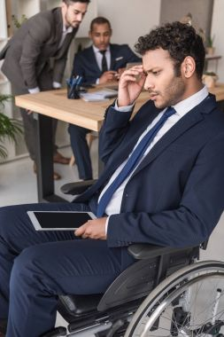 disabled african american businessman with tablet
