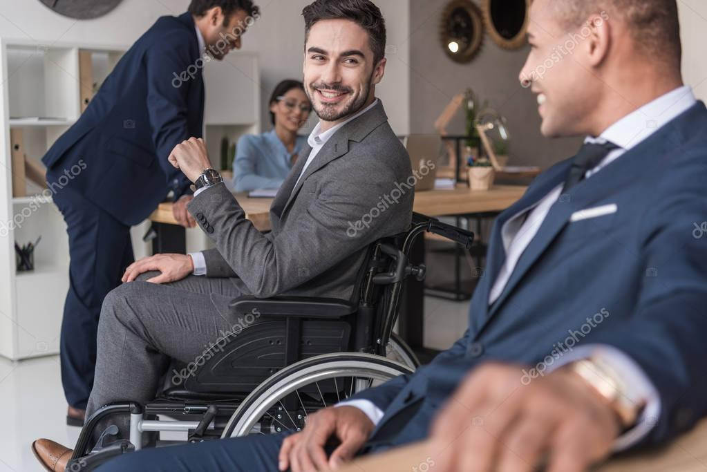 smiling disabled businessman in office