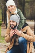 daughter piggybacking her father