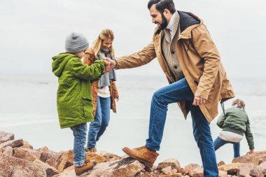 family spending time on seashore