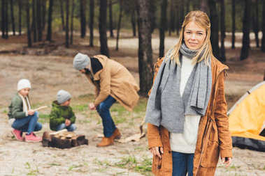 woman on camping her with family