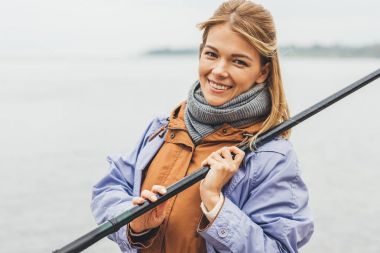 woman with fishing rod