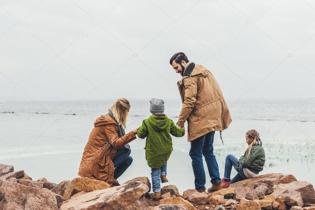 family spending time on seashore