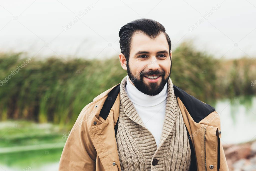 young man in sweater and jacket
