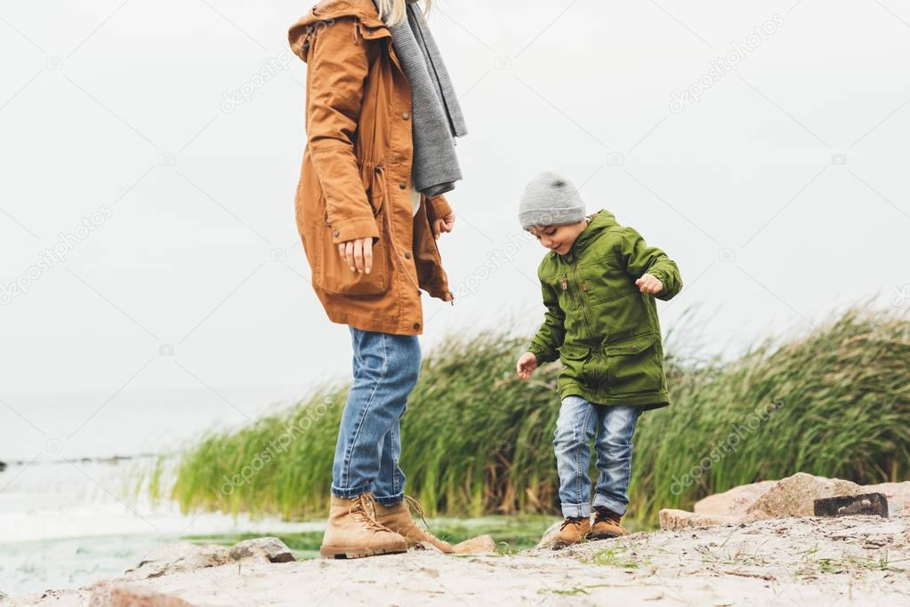 mother and son spending time on coast